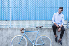 Man sitting on the wall Stock Photos