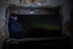 Looking the aurora. Man sitting and watching the aurora Royalty Free Stock Photography
