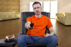 Man Sitting and Watching Football At Home Royalty Free Stock Images