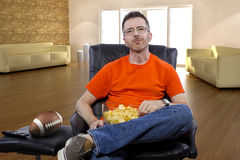 Man Sitting and Watching Football At Home Royalty Free Stock Photography