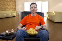 Man Sitting and Watching Football At Home Royalty Free Stock Photos