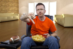 Man Sitting and Watching Football At Home Stock Photos