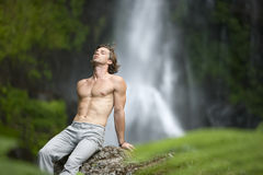 Man Sitting Waterfalls Stock Images