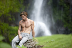 Man Sitting Waterfalls Stock Photography