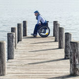 Man sitting in wheelchair Royalty Free Stock Photography