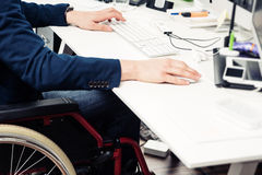 Man Sitting In Wheelchair Working In Modern Office Stock Image