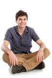 Man sitting on white background Stock Photo