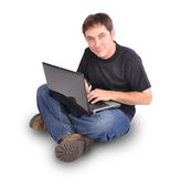 Man Sitting on White with Laptop Computer Royalty Free Stock Photography