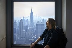 Man sitting in the window. Royalty Free Stock Photography