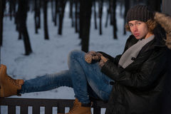 Man sitting in the winter park Stock Image