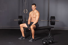 Man sitting at a workout place and smiling to camera Stock Image