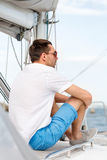 Man sitting on yacht deck Royalty Free Stock Photos