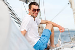 Man sitting on yacht deck Stock Images