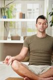 Man sitting in yoga position Royalty Free Stock Photos