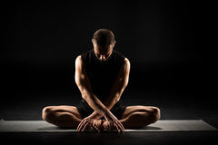 Man sitting in yoga position Stock Photos