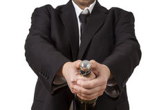 Man in siut opening Champagne bottle Royalty Free Stock Image