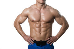 Man With Six Pack Close-up Over White Background. Young Muscular Man Posing In Studio Showing Abs - Isolated On White Background Royalty Free Stock Photos