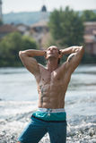 Man With Six Pack Outdoors In Nature Stock Images