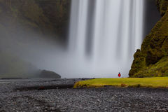 Man by a  Skógafoss waterfall Royalty Free Stock Photo