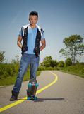 Man with skateboard Stock Images
