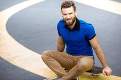 Man with skateboard outdoors royalty free stock photo