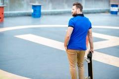 Man with skateboard outdoors stock photos