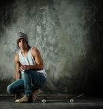 Man with a skateboard Royalty Free Stock Image