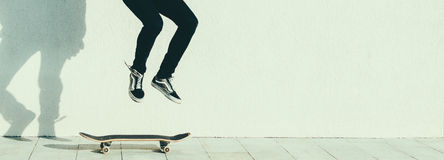 Man On Skateboard. Young man jumping on the skateboard on the city street Royalty Free Stock Photos
