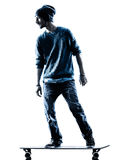 Man skateboarder skateboarding silhouette Royalty Free Stock Image