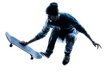 Man skateboarder skateboarding silhouette Royalty Free Stock Photography