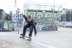 Man skateboarding in action in the skate park. Stock Photography