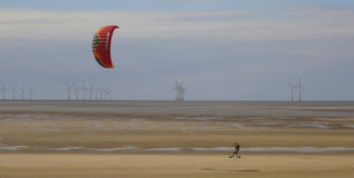 A Man Skateboards with a Parasail Near Wallasey Royalty Free Stock Photos