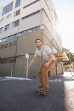 Man skating on city street Stock Photo