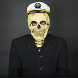Man - skeleton in a naval cap Royalty Free Stock Images