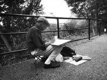 Man sketching Stock Images