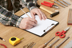 Man sketching a DIY project on paper Royalty Free Stock Photos