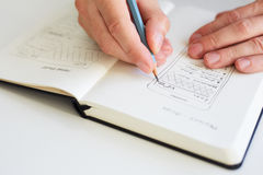 Man sketching graphic sketch in office royalty free stock photo