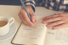 Man sketching graphic sketch in office royalty free stock photos