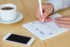 Man sketching web design. In office, close up Royalty Free Stock Images