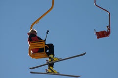 Man with ski on the chair lift. At winter resort Stock Images