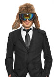 Man in ski goggles and black suit Stock Photo