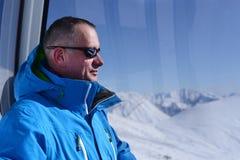 Man in ski gondola Stock Photography
