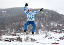 Man in ski helmet jumps on mountain Royalty Free Stock Image