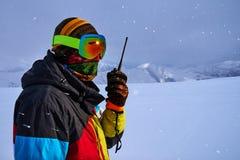 Man in a ski mask says on  radio Royalty Free Stock Photo