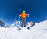 Man with ski mask skiing in action view from below Royalty Free Stock Image