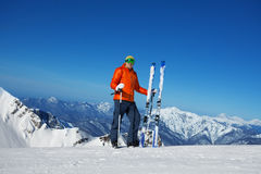 Man in ski mask stands and beautiful mountain view Royalty Free Stock Image