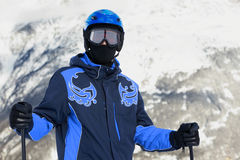 Man in ski suit and helmet Royalty Free Stock Images