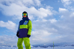 Man in a ski suit standing and looking Royalty Free Stock Image