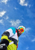 Man in  ski suit standing and looking into  camera Stock Photography