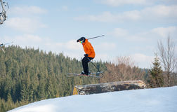 Man skier in flight during a jump over a hurdle Royalty Free Stock Photo